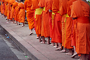 Laos. Luang Prabang. Early morning alms round of the Buddhist monks.