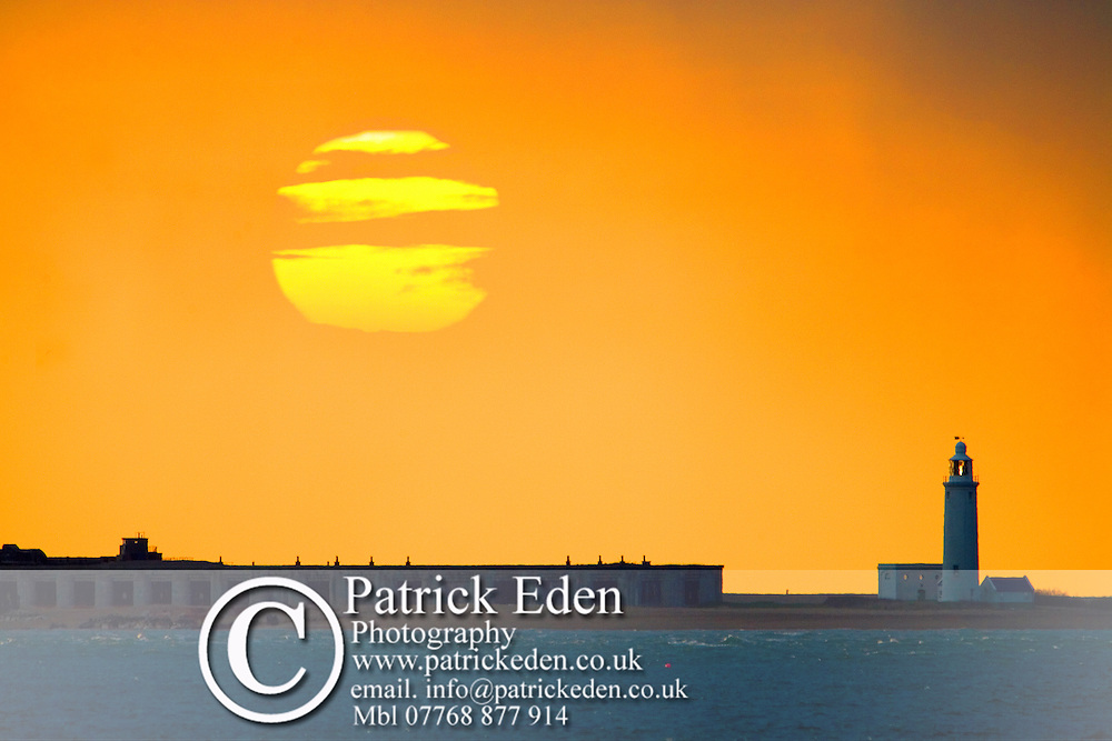 Hurst Castle Light house, sunset, Totland bay, Photographs of the Isle of Wight by photographer Patrick Eden photography photograph canvas canvases