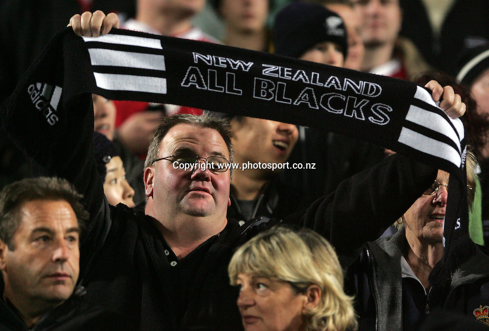 All Black fasn sing the national anthems prior to the All Blacks v Fiji test match played at Albany Stadium in Auckland on Friday 10 June, 2005. The All Black won 91-0. Photo: Michael Bradley/PHOTOSPORT