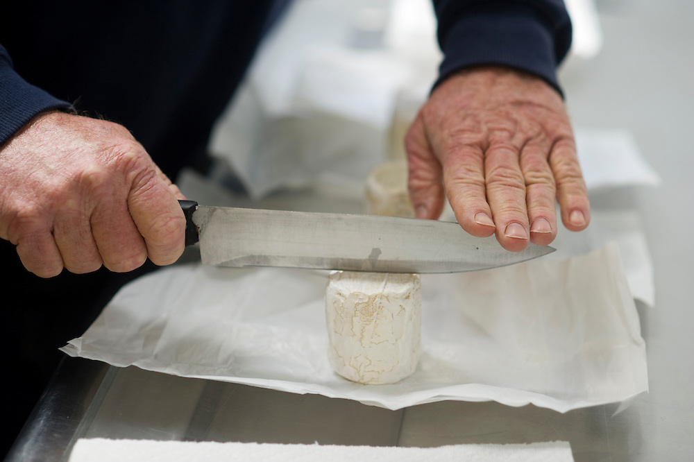 Goat cheese being cut