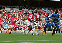 Photo: Lee Earle.<br /> Arsenal v Portsmouth. The FA Barclays Premiership. 02/09/2007.Kanu (R) scores for Portsmouth.