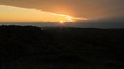 The sun rises over a cloud bank to illuminate the northern Keweenaw Peninsula of Michigan, on October 6, 2015.