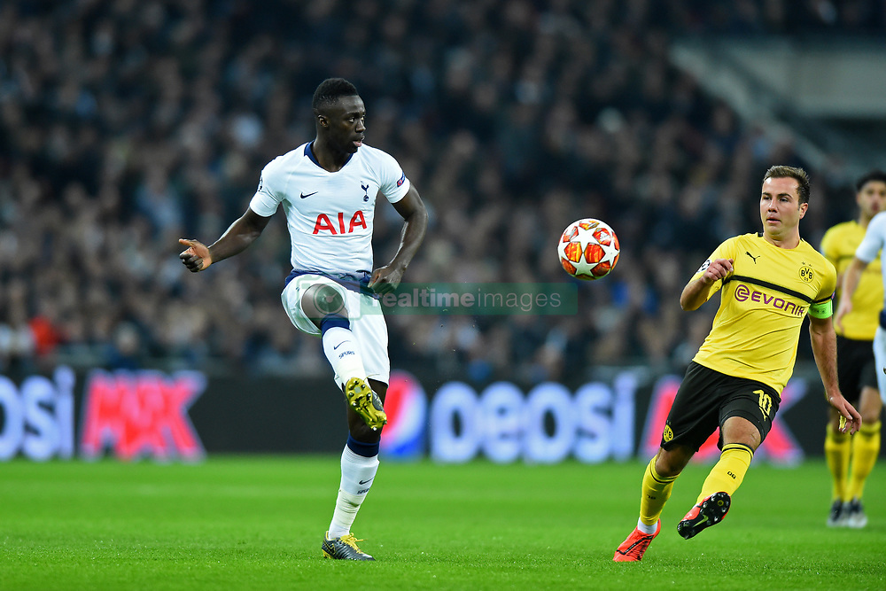 February 13, 2019 - London, England, United Kingdom - Tottenham defender Davinson Sanchez clears his line from Borussia Dortmund midfielder Mario Gotze during the UEFA Champions League match between Tottenham Hotspur and Ballspielverein Borussia 09 e.V. Dortmund at Wembley Stadium, London on Wednesday 13th February 2019. (Credit: Jon Bromley | MI News & Sport Ltd) (Credit Image: © Mi News/NurPhoto via ZUMA Press)