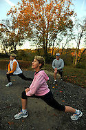 Baby Boomers (age 55-65) who live at Sun City Carolina Lakes, a 55+ no-children residential development near Indian Land, South Carolina, take an early morning run through the development and do some stretching. Pictures are model-released for non-advertising use.