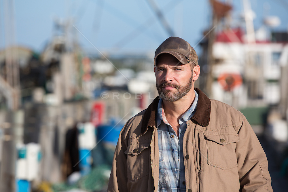 portrait of a handsome fisherman on a pier in Montauk, NY