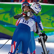 Winter Olympics, Vancouver, 2010.Lindsey Vonn, USA, (left) after crashing out of the Ladies Super Combined during competition, congratulates team mate Julia Mancuso, who won the Silver Medal in the competition at Whistler Creekside, Whistler, during the Vancouver Winter Olympics. 18th February 2010. Photo Tim Clayton