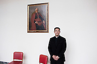 ROME, ITALY - 6 MARCH 2013: (L-R) Seminarian Junhee Lee, 25 years old from Brooklyn, NY, poses for a portrait in front of a painting Cardinal Gaetano Bisleti, Protector of the College from 1918 to 1937, at the Pontifical North American College in Rome, Italy, on March 6, 2013. Junhrr Lee is attending his 4th year of studies at the Pontifical North American College...The Pontifical North American College is a Roman Catholic educational institution that forms seminarians for priestly ministry in the dioceses in the United States and that provides a residence for American priests pursuing graduate studies...Gianni Cipriano for The New York Times10139468AROME, ITALY - MARCH 10: U.S. Cardinal Timothy Dolan of New York City arrives at the Our Lady of Guadalupe church in the Monte Mario district where he is the titular head to give a Sunday Mass, in Rome, Italy, on March 10, 2013. Cardinals are set to enter the conclave to elect a successor to Pope Benedict XVI after he became the first pope in 600 years to resign from the role. The conclave is scheduled to start on March 12 inside the Sistine Chapel and will be attended by 115 cardinals as they vote to select the 266th Pope of the Catholic Church...Gianni Cipriano for The New York Times