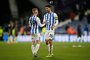 Lewis O'Brien of Huddersfield Town and Christopher Schindler of Huddersfield Town shake hands at full time during the EFL Sky Bet Championship match between Huddersfield Town and Brentford at the John Smiths Stadium, Huddersfield, England on 18 January 2020.