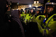Met police riot officers confronted by student protesters in Trafalgar Square.