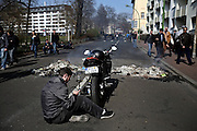 Frankfurt am Main | 18 Mar 2015<br /> <br /> Blockupy-Proteste in Frankfurt am 18.03.2015, hier: Ein Demonstrant ist mit dem Motorrad gekommen und raucht in aller Ruhe auf der blockierten Obermainanlage eine Wasserpfeife.<br /> <br /> photo &copy; peter-juelich.com