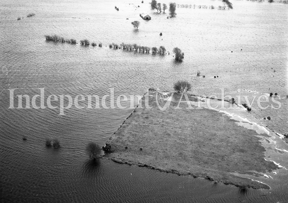 A28(7) Athlone Floods.   (29/12/59) (Part of the Independent Newspapers Ireland/NLI collection.)<br /> <br /> <br /> These aerial views of Ireland from the Morgan Collection were taken during the mid-1950's, comprising medium and low altitude black-and-white birds-eye views of places and events, many of which were commissioned by clients. From 1951 to 1958 a different aerial picture was published each Friday in the Irish Independent in a series called, 'Views from the Air'.<br /> The photographer was Alexander 'Monkey' Campbell Morgan (1919-1958). Born in London and part of the Royal Artillery Air Corps, on leaving the army he started Aerophotos in Ireland. He was killed when, on business, his plane crashed flying from Shannon.