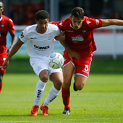Dovers forward Jamie Allen is heald back by Wrexhams midfielder Luke Young during the opening National League match between Dover Athletic and Wrexham FC at Crabble Stadium, Kent on 04 August 2018. Photo by Matt Bristow.