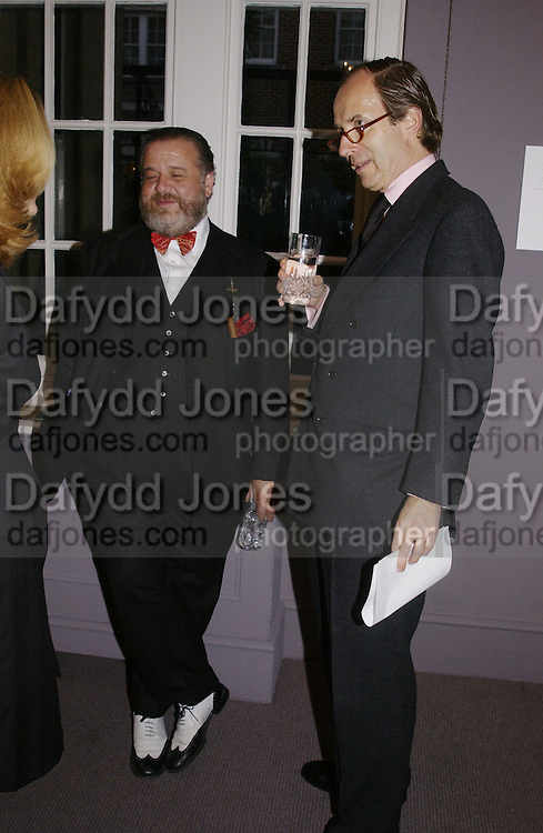 Pete Batkin and Simon de Pury. The preview of the forthcoming auction of photographs. Philips de Pury and Luxembourg. 26 September 2002.  of © Copyright Photograph by Dafydd Jones 66 Stockwell Park Rd. London SW9 0DA Tel 020 7733 0108 www.dafjones.com