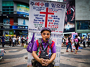 10 JUNE 2018 - SEOUL, SOUTH KOREA: A street preacher on Myeong-dong, a busy shopping street in Seoul. Christianity is the second largest religion in South Korea.    PHOTO BY JACK KURTZ
