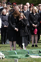 © Licensed to London News Pictures. 19/04/2012. DIDCOT, UK. Mourners during the funeral of  Lance Corporal Michael Foley, Adjutant General's Corps (Staff and Personnel Support). He was shot dead by an Afghan soldier on March 26. He is survived by his wife Sophie (pictured centre right) and their three young sons who did not attend the service. His mother Debbie (pictured centre left) also attended. Photo credit :  Cliff Hide/LNP