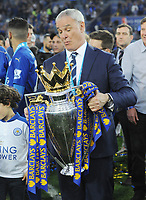 Football - 2015 / 2016 Premier League - Leicester City vs. Everton<br /> <br /> Leicester Manager Claudio Ranieri glances down at the trophy at the King Power Stadium.<br /> <br /> COLORSPORT/ANDREW COWIE