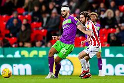 Marlon Pack of Bristol City is challenged by Joe Allen of Stoke City - Rogan/JMP - 01/01/2019 - Bet365 Stadium - Stoke, England - Stoke City v Bristol City - Sky Bet Championship.