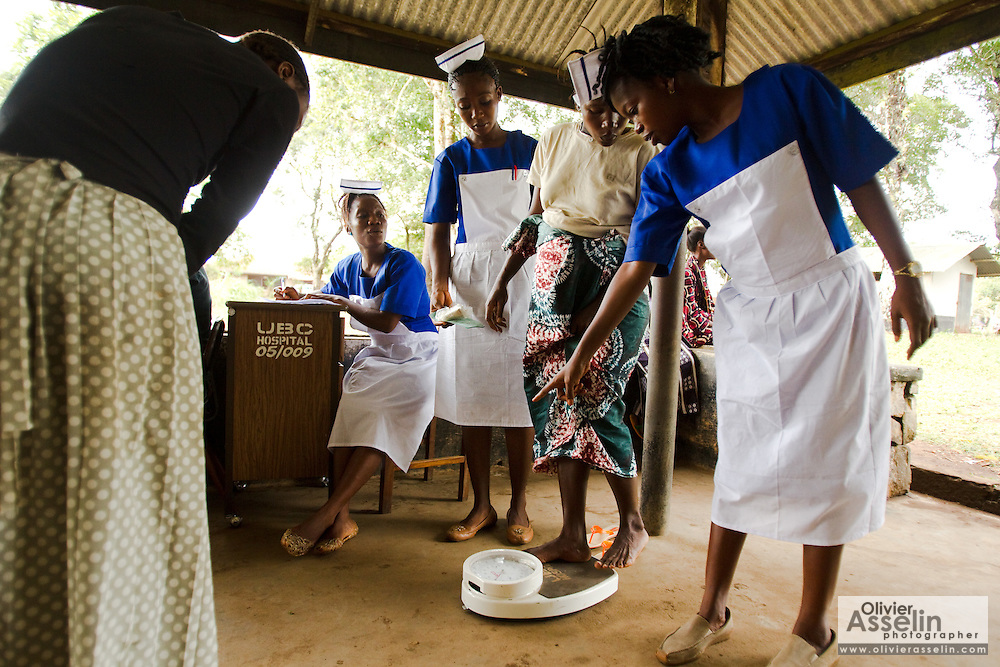 A pregnant woman stands on a body scale during a prenatal clinic at the UBC hospital in Mattru Jong, Sierra Leone on Friday April 23, 2010.