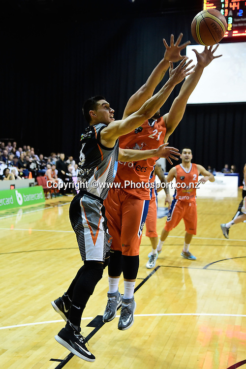 Jarrod Kenny (L) of the Hawks jumps to shoot with James Paringatai of the Sharks in defense during a NBL - Hawks vs Sharks semi final four basketball match at the TSB Arena in Wellington on Friday the 4th of July 2014. Photo by Marty Melville/www.Photosport.co.nz
