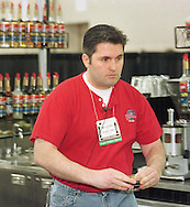 Max Gabriello, of Andover, Mass., delivers espressos to the judges during the Torani 5th Annual Barista Cup, Monday, May 3, 1999, in Philadelphia. Gabriello, declared best Barista in the USA, won a trip to Italy. (Photo by William Thomas Cain)