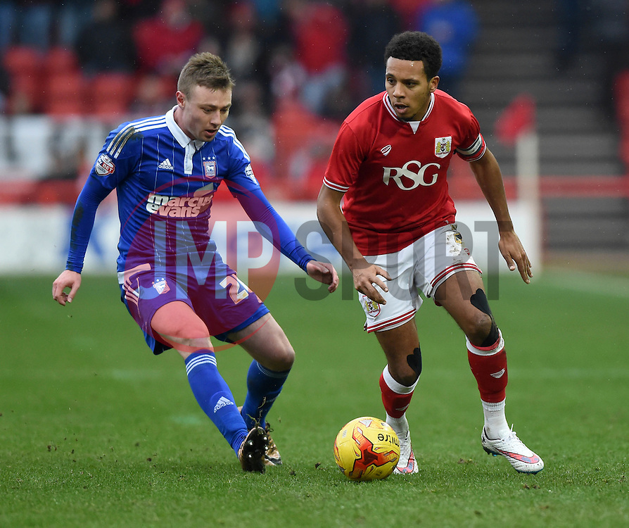 Korey Smith of Bristol City battles for the ball with Freddie Sears of Ipswich Town  - Mandatory byline: Joe Meredith/JMP - 13/02/2016 - FOOTBALL - Ashton Gate - Bristol, England - Bristol City v Ipswich Town - Sky Bet Championship
