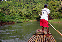 Rafting on the martha Brae River in Jamaica. Rafts made from Bamboo and are 30 foot long and are operated by experienced Captains. This is a very popular tourist attraction in Jamaica, The attraction is twenty five miles from Monteo Bay and 40 miles from Ocho Rios.