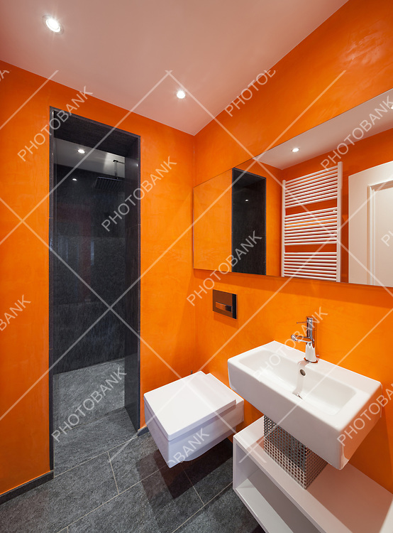 Interior of house, modern bathroom, orange walls