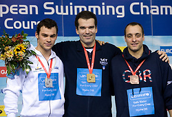 Christian GALENDA of Italy (2nd place), Winner Peter Mankoc of Slovenia  (9th times European Champion) and James GODDARD of Great Britain at medal ceremony at Men`s 100m Individual Medley at day 4 of LEN European Short Course Swimming Championships Rijeka 2008, on December 14, 2008,  in Kantrida pool, Rijeka, Croatia. (Photo by Vid Ponikvar / Sportida)