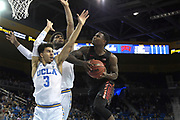 Nov 15, 2019; Los Angeles, CA, USA; UNLV Rebels guard Amauri Hardy (3) is defended by UCLA Bruins guard Jules Bernard (3) and forward Cody Riley (2) in the first half at Pauley Pavilion. UCLA defeated UNLV 71-54.