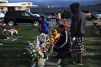 A family member takes time to pray as night falls. In a touching final celebration of All Soul's Day on Saturday, hundreds of congregants came to Queen of Heaven Cemetery in Salinas to attend mass, offer their prayers, and as dusk fell, participate in a candlelight procession.  Friends and family members sat by the graves of loved ones, many of which were decorated with traditional Day of the Dead marigolds, photographs of the departed, and things that were their favorites in life.