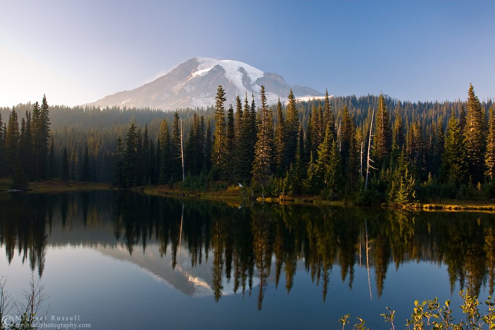 Fire Smoke from nearby forest firest partially obscures Mount Rainier at Reflection Lakes.  Photographed at sunset from the Reflection Lakes area in Mount Rainier National Park, Washington State, USA