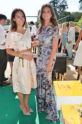 Left to right, LAVINIA BRENNAN and LADY NATASHA RUFUS-ISAACS at the Summer Solstice Party during the Boodles Tennis event hosted by Beulah London and Taylor Morris at Stoke Park, Park Road, Stoke Poges, Buckinghamshire on 21st June 2014.