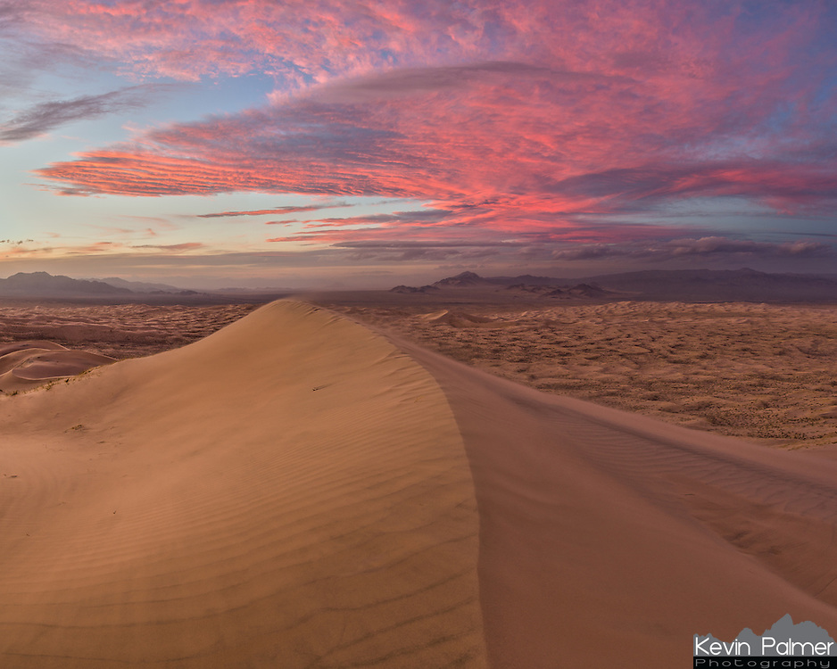 After the sun went down over the sand dunes, the sky lit up with color in every direction. Located in Mojave National Preserve, the Kelso Dunes are among the tallest in the United States. 700 feet above the desert floor, the strong winds were blowing sand everywhere.<br /> <br /> Date Taken: 1/30/14