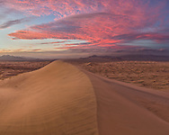 After the sun went down over the sand dunes, the sky lit up with color in every direction. Located in Mojave National Preserve, the Kelso Dunes are among the tallest in the United States. 700 feet above the desert floor, the strong winds were blowing sand everywhere.<br />