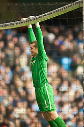 MANCHESTER, ENGLAND - Sunday, January 31, 2010: Manchester City's goalkeeper Shay Given hangs off the cross-bar during the Premiership match against Portsmouth at the City of Manchester Stadium. (Photo by David Rawcliffe/Propaganda)