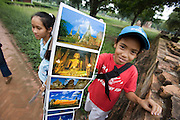 Wat Mahathat. Kids selling postcards to tourists.