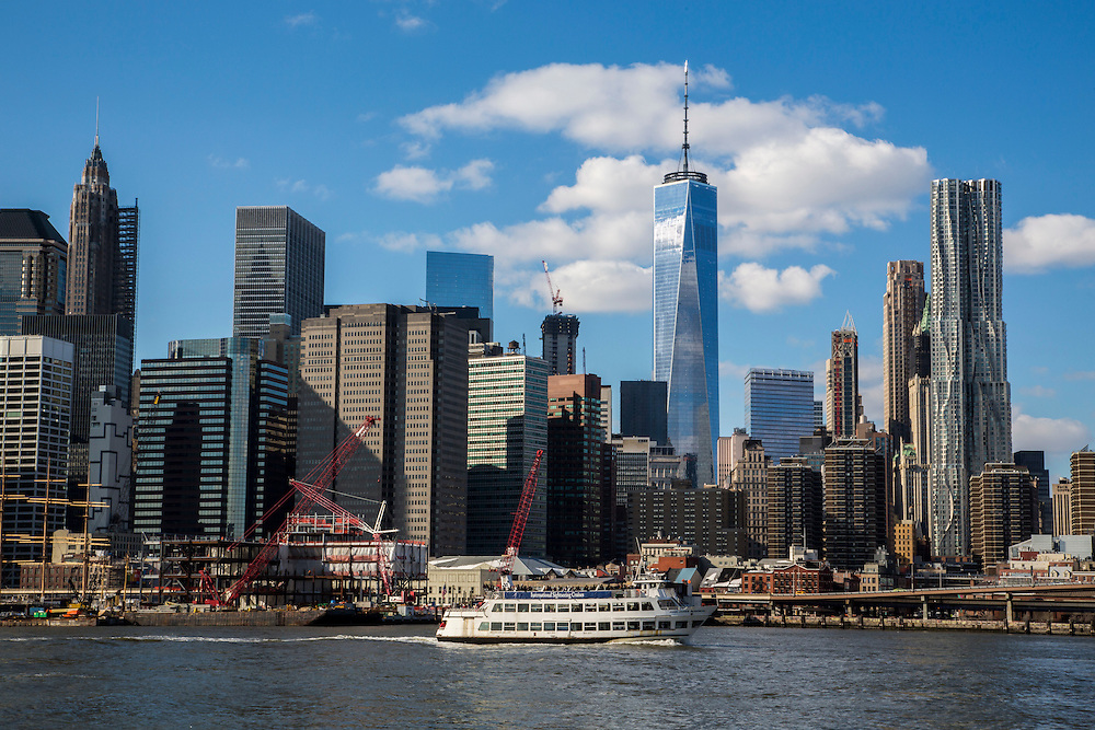 An International Sightseeing Cruises boat sails along the East River passing Lower Manhattan, also know as Downtown Manhattan which is the financial district and centre for business, culture and government in the city of New York, United States of America. Photographed across the East River from Brooklyn. <br /> (photo by Andrew Aitchison / In pictures via Getty Images)
