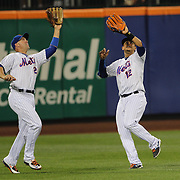Left fielder Michael Cuddyer, (left) and center fielder Juan Lagares, New York Mets, nearly collide for the second time in the match as Michael Cuddyer make the catch during the New York Mets Vs Baltimore Orioles MLB regular season baseball game at Citi Field, Queens, New York. USA. 5th May 2015. Photo Tim Clayton