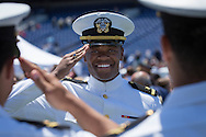 Navy Ensign Alexander Johnson gets his first salute as a Naval officer after the  Graduation & Commissioning Ceremony at the United States Naval Academy on Friday May 22, 2015. (Alan Lessig/Staff)