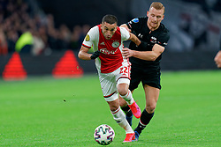 Hakim Ziyech #22 of Ajax and Dani de Wit #10 of AZ Alkmaar in action during the Dutch Eredivisie match round 25 between Ajax Amsterdam and AZ Alkmaar at the Johan Cruijff Arena on March 01, 2020 in Amsterdam, Netherlands