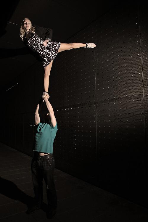 Artistic cheerleading Single based partner stunt arabesque under the leeds train station bridge