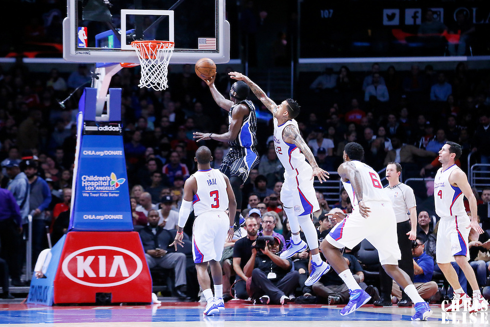 03 December 2014: Orlando Magic guard Victor Oladipo (5) goes for the layup past Los Angeles Clippers forward Matt Barnes (22) during the Los Angeles Clippers 114-86 victory over the Orlando Magic, at the Staples Center, Los Angeles, California, USA.