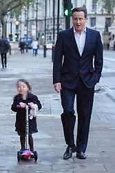 © licensed to London News Pictures. London, UK 17/12/2013. EDITORS NOTE: FACE PIXELATED Prime Minister David Cameron leaving Downing Street with his daughter Florence on Tuesday, December 17, 2013. Photo credit: Tolga Akmen/LNP