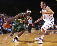Cleveland State forward Patrick Tatham (21) drives against pressure form Kansas State Center Jason Bennett (55) in the first half at Bramlage Coliseum in Manhattan, Kansas, December 5, 2006.  K-State beat the Vikings 93-60.<br />