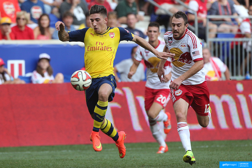 Hector Bellerin, (left), Arsenal, challenged by Eric Alexander, New York Red Bulls, during the New York Red Bulls Vs Arsenal FC,  friendly football match for the New York Cup at Red Bull Arena, Harrison, New Jersey. USA. 26h July 2014. Photo Tim Clayton