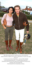 MR TIM ATTIAS former close friend of Jerry Hall and MISS MARTHA VISEDO at a party in Berkshire on 23rd July 2003.PLS 137