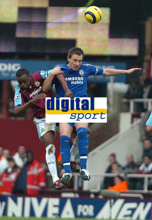 Photo: Ed Godden.<br />West Ham United v Chelsea. The Barclays Premiership.<br />02/01/2006. <br />John Terry (R) reaches high over the West Ham captain Nigel Reo-Coker.