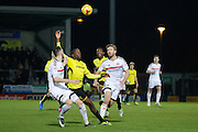 Burton Albion striker Lucas Akins (10) wins the ball from Fulham defender Tomas Kalas (26) during the EFL Sky Bet Championship match between Burton Albion and Fulham at the Pirelli Stadium, Burton upon Trent, England on 1st February 2017. Photo by Richard Holmes.