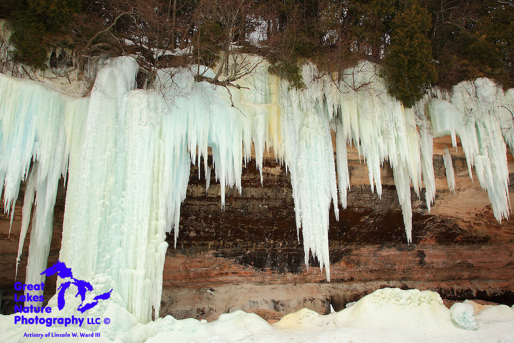The extraordinary winter of 2013-2014 provided us with an amazing bit of natural artistry, as water, leaching through the porous sandstone cliffs of Grand Island, froze to create the Grand Island Ice Caves. I captured these images on March 13, 2014, after walking across frozen Lake Superior from the Pictured Rocks National Lakeshore headquarters. Because of the very harsh lighting during my visit, I elected to record many of the images in black and white.