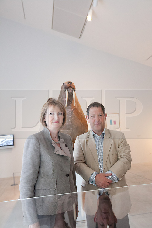"© London News Pictures. 25/6/2013. Margate, Kent. Harriet Harman MP and John Kampfner Chairman of Turner Contemporary   stands in front of the Horniman Museum walrus. Today Harriet Harman MP, Labour's Deputy Leader and Shadow Secretary of State for Culture, Media and Sport, visits Margate where she was given a tour of Turner Contemporary before meeting staff and local businesses in the ""Curious Margate"" project. Picture credit Manu Palomeque/LNP"